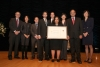 The USPTO team holding their award aside Deputy Secretary Andrews.