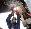 A US Navy welder works at the Puget Sound Naval Shipyard. Photo courtesy US Navy.