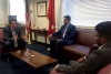 Steve Haro, Assistant Secretary for Legislative and Intergovernmental Affairs, interacts with colleagues in his office.