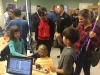 PDX Makers booth - Kids trying out a musical instrument that uses a small laser to generate notes