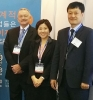 LED FastStart Executive Director Jeff Lynn and LED Korea's Eun Mee Ko and Young Ho Seo at KOMAF 2015 in Seoul.