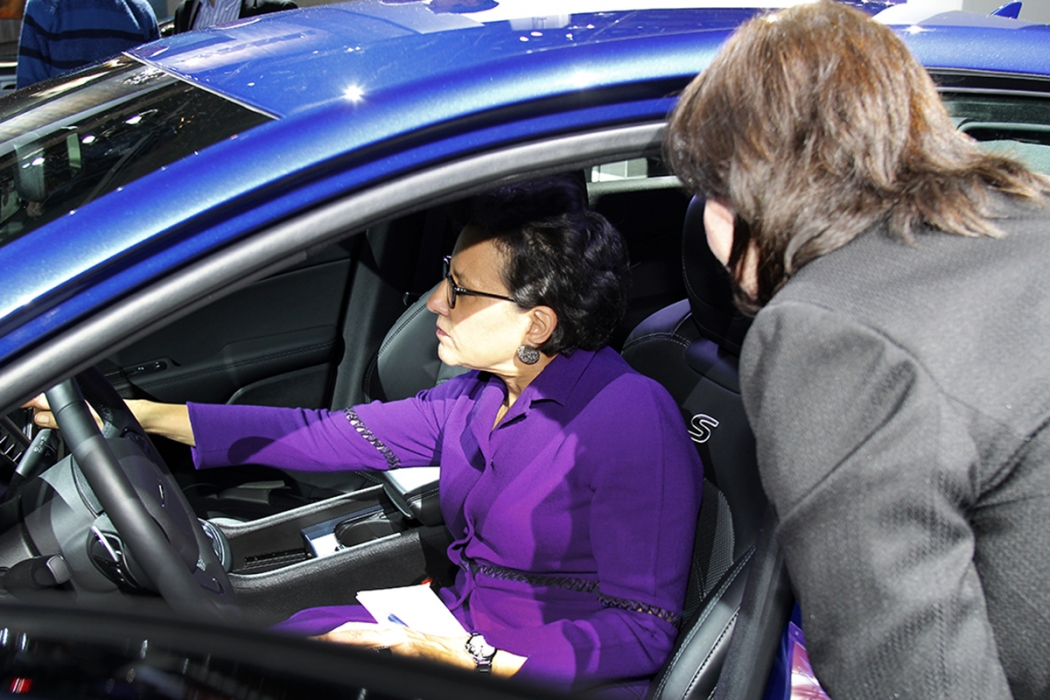 Pritzker sits at the wheel of a new car