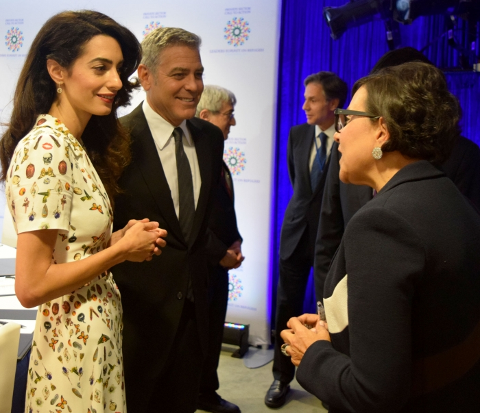 Secretary Pritzker George and Amal Clooney at Refugee Roundtable