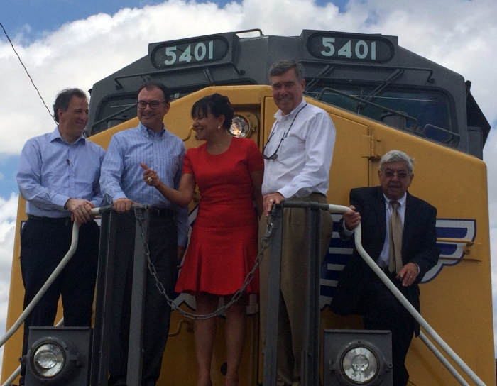 Secretary of Commerce Penny Pritzker joined U.S. and Mexican government leaders in Brownsville, Texas on the front of a locomotion engine