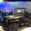 Secretary Pritztker views the 1960's Army vehicle Willy's Jeep at the International Technology Show (IMTS) in Chicago.