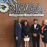 EDA Assistant Secretary Jay Williams with manufacturing students from NWGA College and Career Academy in Dalton, Georgia.