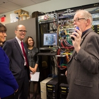 Secretary of Labor Tom Perez and Secretary of Commerce Penny Pritzker tour the cyber security training center at Montgomery College in Maryland on Dec. 10, 2014.